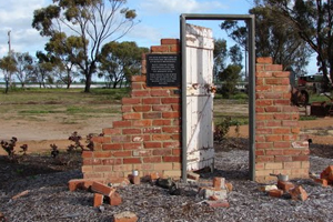 Meckering earthquake ruins: a door and remnants of a brick wall remain.