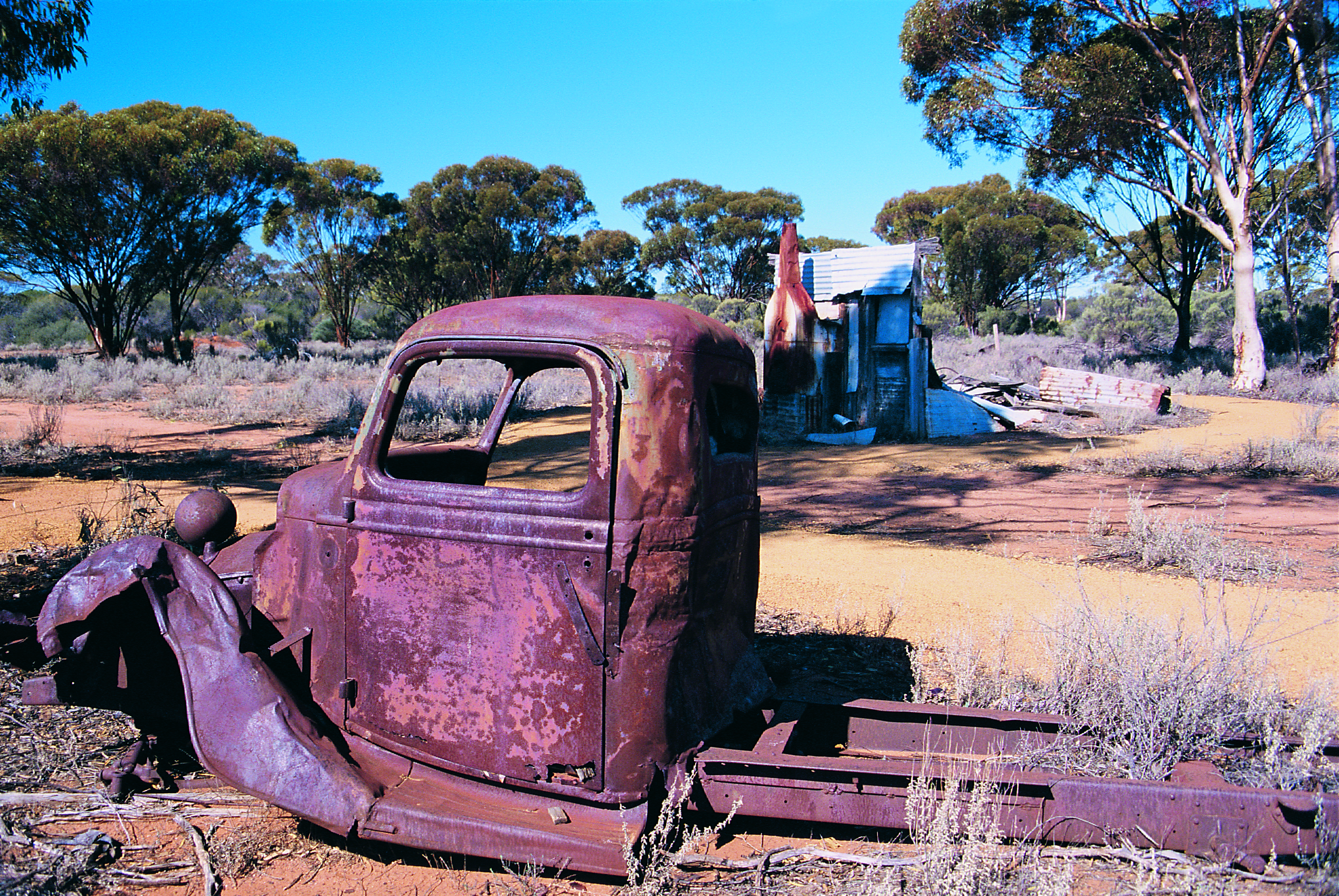 A rusting truck and shed, remains of the once thriving place.